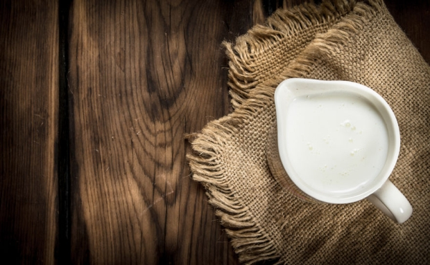 62001438 - mug of milk. on a wooden table.