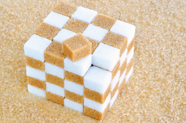 24693011 - cube of brown and white sugar cubes