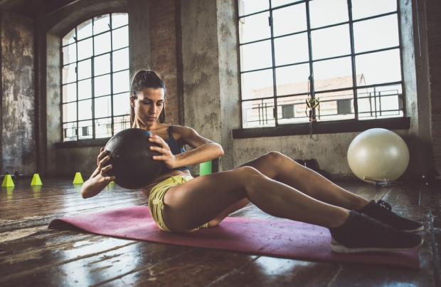 71078512 - woman training with functional gymnastic in the gym