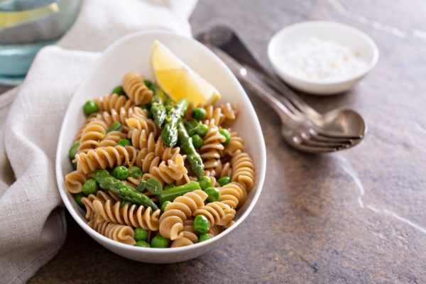50968031 - whole wheat pasta with green peas and asparagus