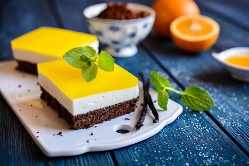 79798739 - delicious chocolate cake bars with mascarpone layer and orange jelly topping