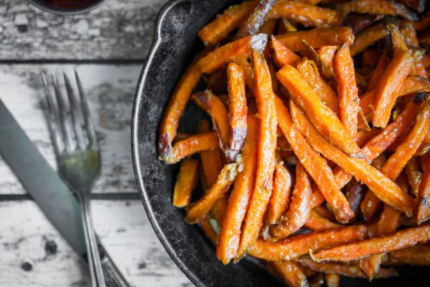45599545 - sweet potato fries in cast iron skillet on wooden background