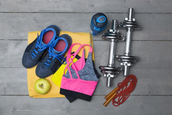 52135128 - top view of colorful fitness equipment on wooden floor