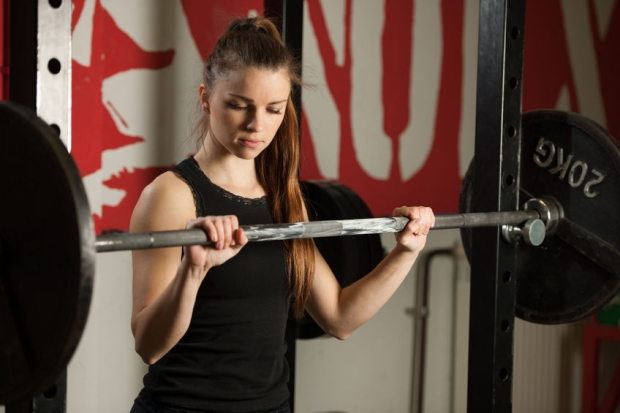 69381519 - woman workout in fitness gym with barbells - powerlift workout