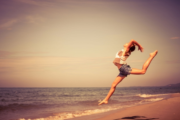 42099299 - teen  girl  jumping on the beach at the day time