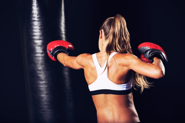 46085623 - beautiful woman with the red boxing gloves. attractive female boxer training.