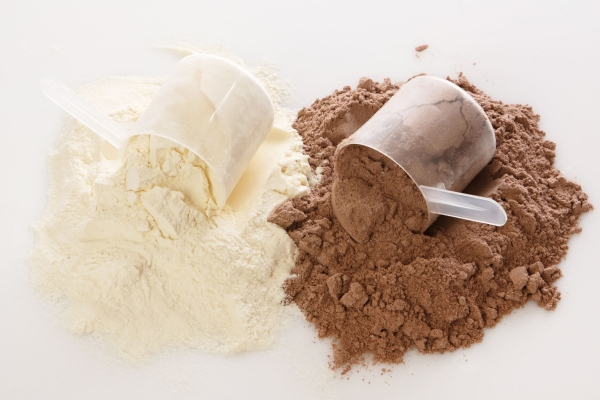 34969313 - close up of protein powder and scoops