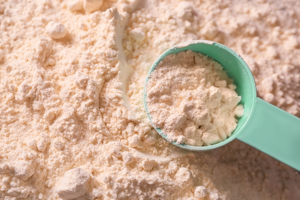 99210300 - protein powder with scoop, closeup