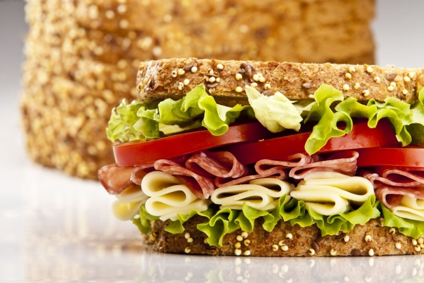 6854182 - salami sandwich with cheese lettuce and tomato