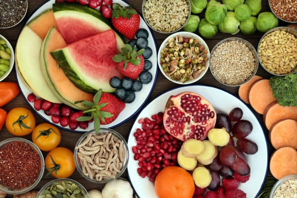 93307860 - health food concept with fresh fruit, vegetables, seeds, pulses, grains and cereals with foods high in vitamins, minerals, anthocyanins, antioxidants and fiber, top view.