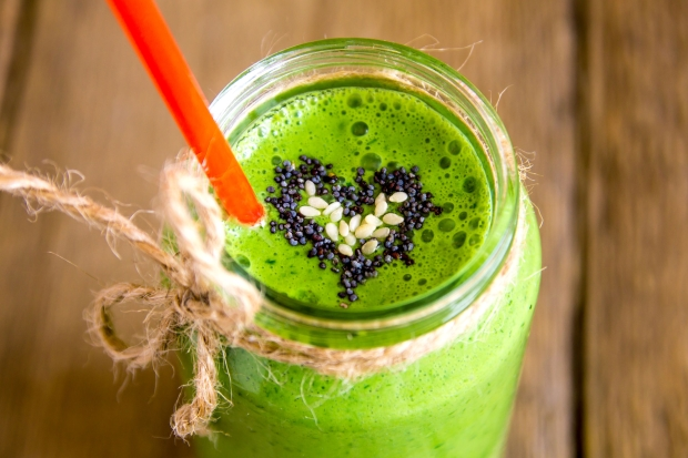 41500829 - green vegetable and herbs smoothie with heart of poppy and sesame seeds. love for a healthy raw food concept.