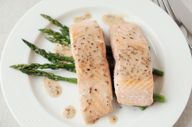 101332414 - low carb keto baked salmon and asparagus, ketogenic food