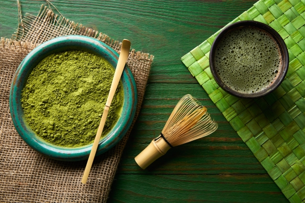 65791842 - matcha tea powder bamboo whisk chasen and spoon for japanese ceremony