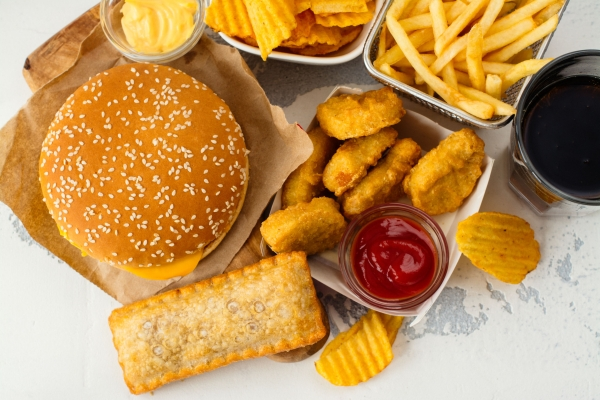 77378693 - junk food on white table. fast carbohydrates not good for health, heart and skin