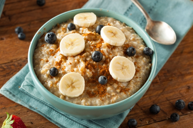 38372481 - homemade healthy steel cut oatmeal with fruit and cinnamon