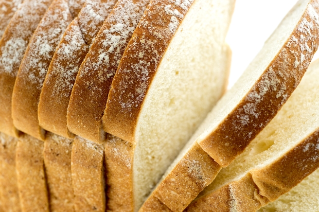 45464688 - closeup macro of loaf of bread with slices