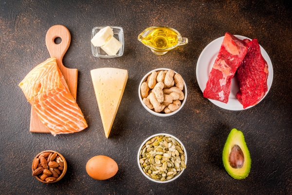 97186117 - ketogenic low carbs diet concept. healthy balanced food with high content of healthy fats. diet for the heart and blood vessels. organic ingredients, dark rusty background, copy space top view