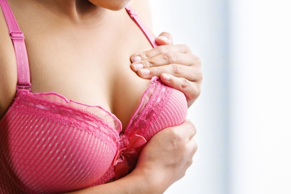 5678504 - woman doing self breast examination using pink bra