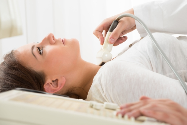 65457949 - young woman doing neck ultrasound examination at hospital
