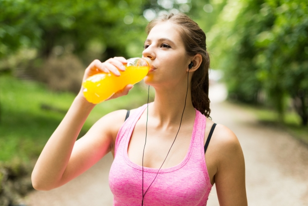 42246229 - young woman drinking after sport