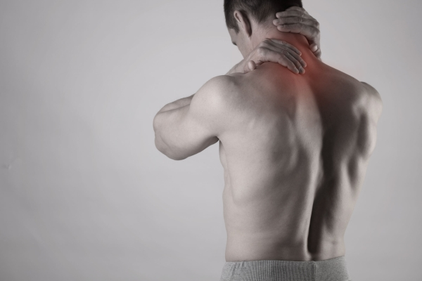 77242644 - muscular man suffering from back and neck pain. incorrect sitting posture problems muscle spasm, rheumatism. pain relief, ,chiropractic concept. sport exercising injury
