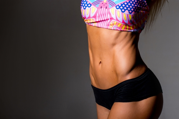 54563662 - close up picture of woman trained abs. close up picture of woman trained abs