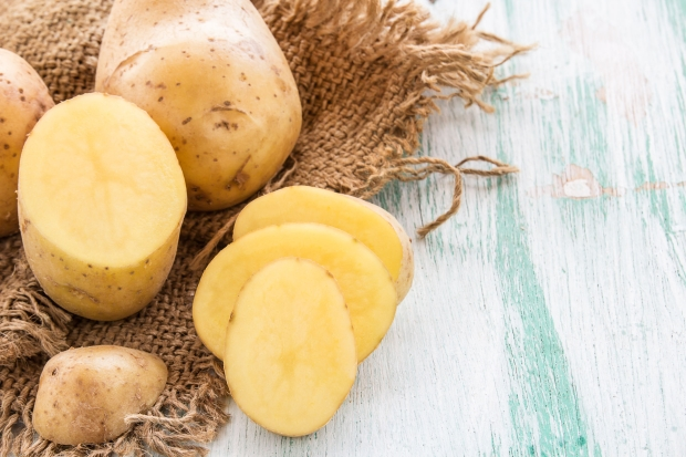 40935567 - sack fresh organic potatoes on a wooden table background