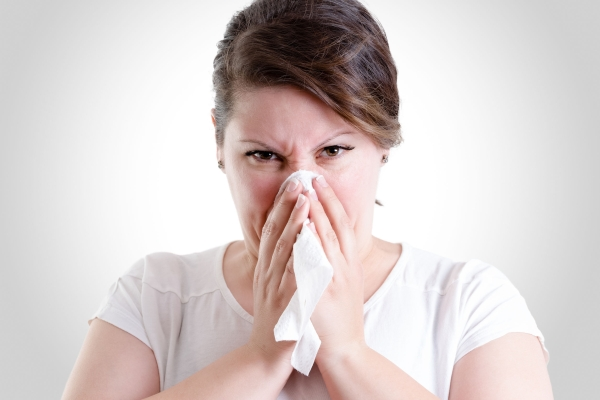47343666 - middle age lady blowing her nose too hard, blowing your nose too hard can give you damage