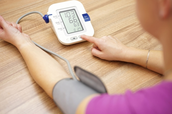 43132927 - woman is taking care for health with hearth beat monitor and blood pressure