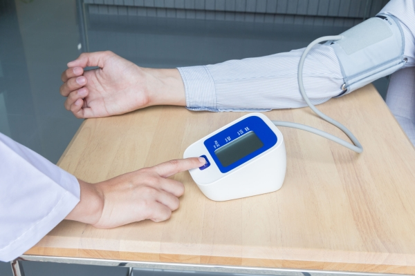 51244311 - concept of woman doctor press start button on blood pressure