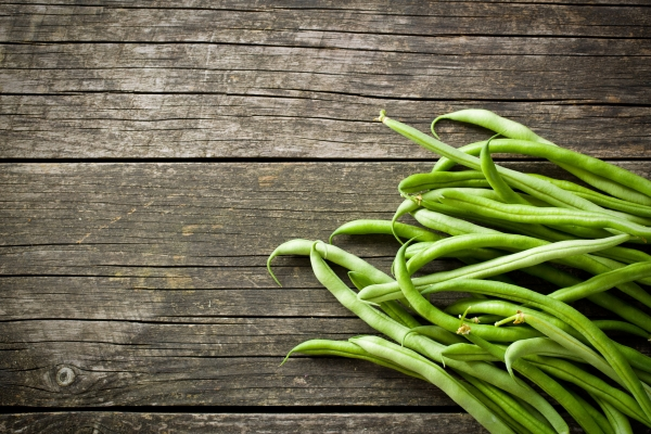 43671695 - green beans on old wooden table