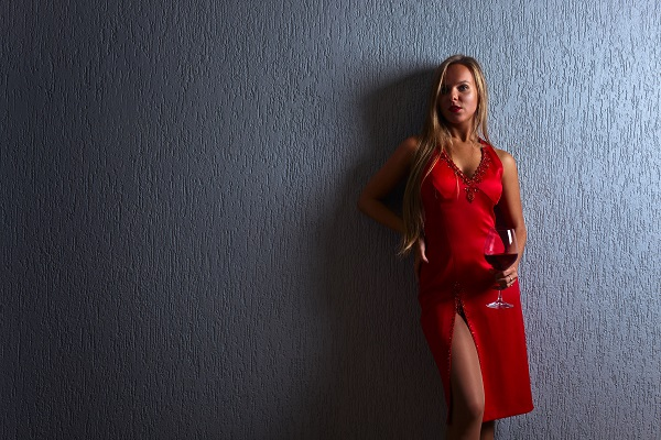 48881349 - the young beautiful woman with red wine