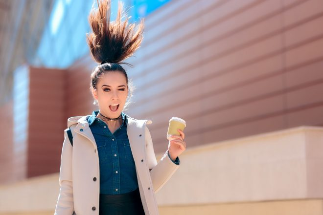 93634930 - funny girl with hot drink coffee cup for extra morning energy