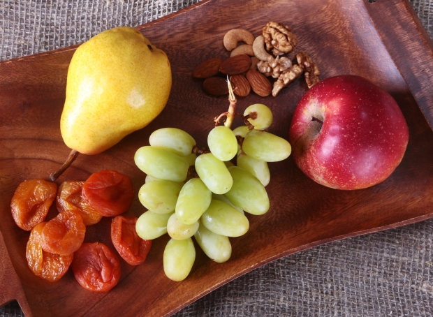 96786051 - fresh organic fruits on wood serving tray. assorted apple, pear, grapes, dried fruits and nuts.