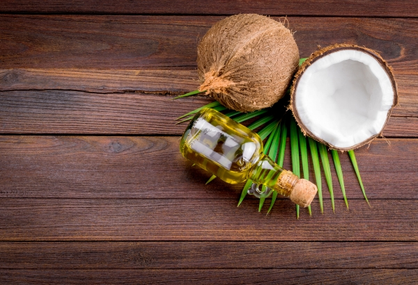 40810188 - coconut and coconut oil on wooden table