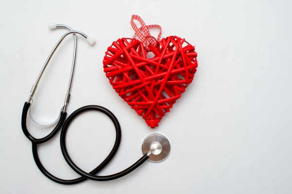 96487957 - medicine. pressure sensor, heart shape, stethoscope and dollars on a wooden background