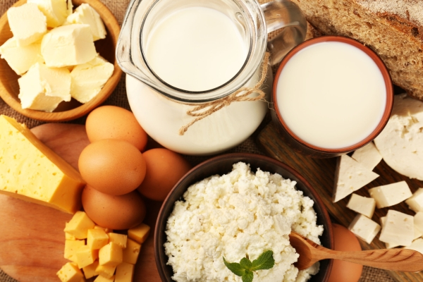 99656976 - tasty dairy products with bread on table close up