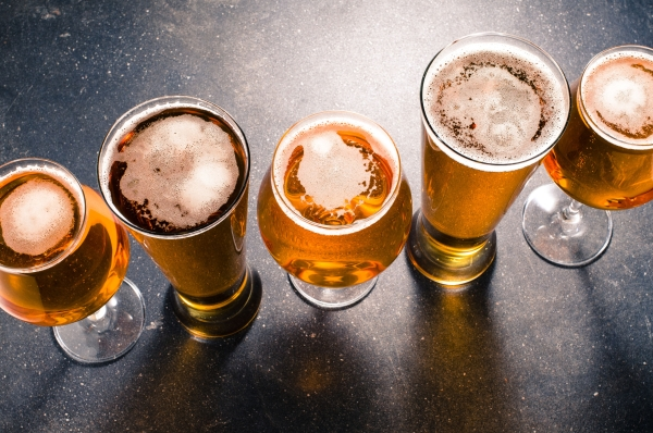 51606752 - beer glasses on a dark table
