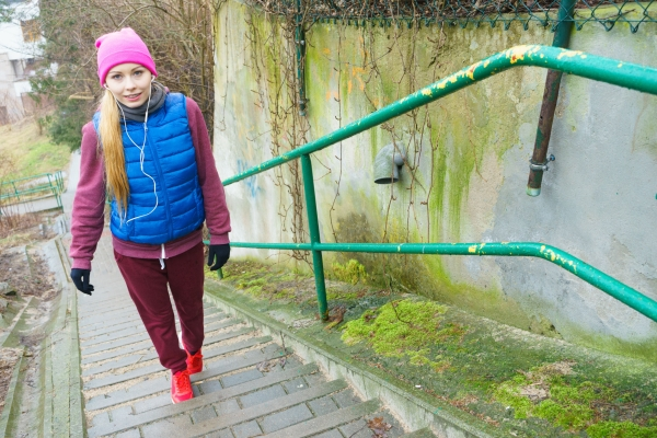 82570238 - outdoor sport exercises, sporty outfit ideas. woman wearing warm sportswear training exercising outside during autumn.