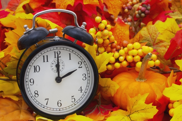 46460640 - autumn time change, autumn leaves and alarm clock with a pumpkin