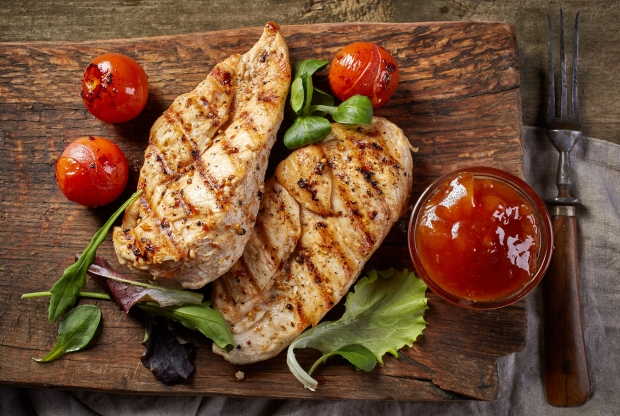 50860911 - grilled chicken fillets on wooden cutting board