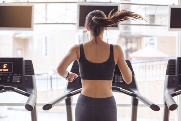 Young female training in gym healthy lifestyle treadmill