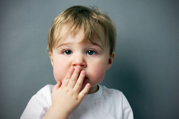 23810393 - oops! cute and funny  little blond boy or toddler with hand in front of mouth