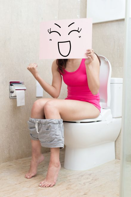 woman take smile billboard and feel excited in the bathroom