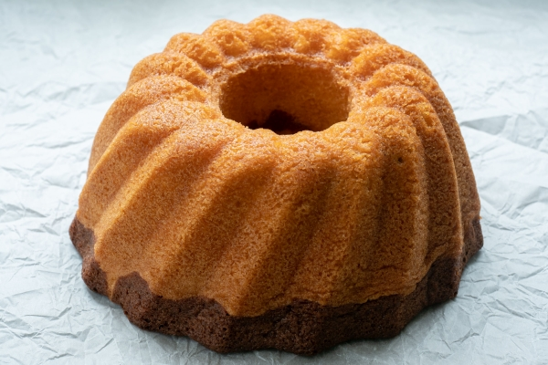 Traditional homemadee freshly baked whole marble cake on paper.