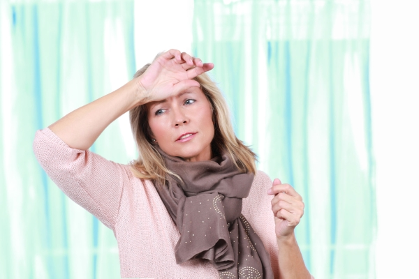 Mature woman with heat wave and headache