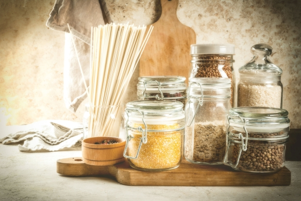 Selection of gluten-free products, cereals: xanthan gum. buckwheat,Rice, rice noodles, chickpeas, lentils, corn, beans, oatmeal. In the home kitchen, in jars. Copy space