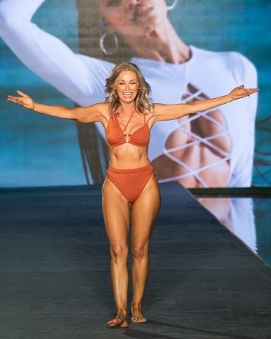 MIAMI, FLORIDA - JULY 10:   Kathy Jacobs walks the runway during the 2021 Sports Illustrated Swimsuit Runway Show during Paraiso Miami Beach at Mondrian South Beach on July 10, 2021 in Miami, Florida. (Photo by Jason Koerner/Getty Images)