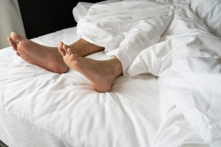Foot man be tired on the bed, couple bed story
